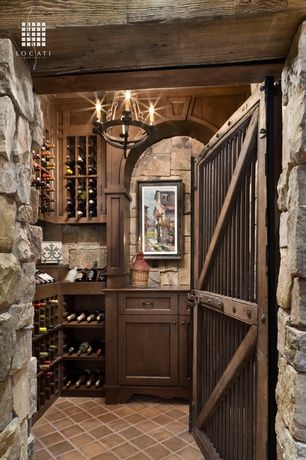 Rustic Wine Cellar with Barn door, Hand made terra cotta cuadrado 12 in. x 12 in. floor and wall tile, Exposed beam