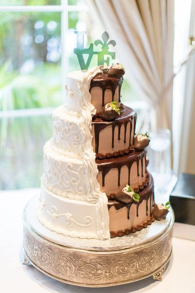 This groom had a unique wedding cake idea! Half vanilla, half chocolate - why not? {Thompson Photography Group}