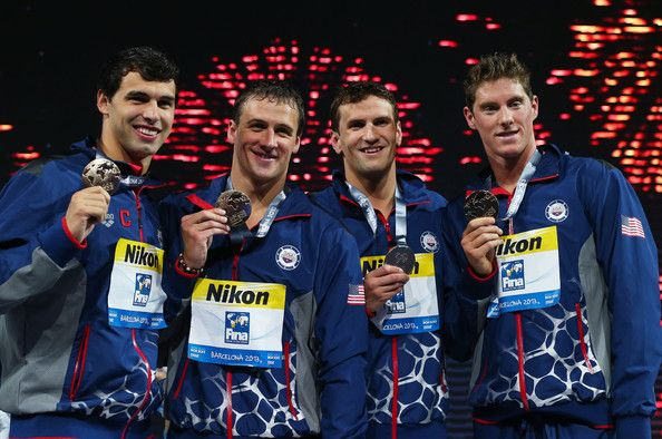 Gold medal winners Conor Dwyer, Ryan Lochte, Charlie Houchin and Ricky Berens of the USA celebrate on the podium after the Men's Freestyle 4x200m Final  on day fourteen of the 15th FINA World Championships at Palau Sant Jordi on August 2, 2013 in Barcelona, Spain.