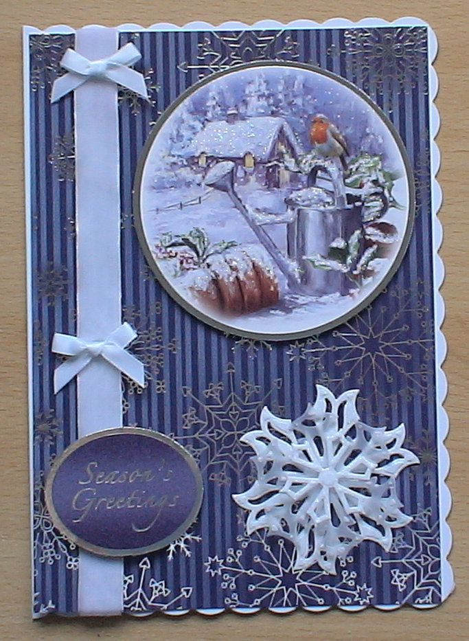 #hunkydory #createandcraft #spellbinders  The card is made using the Hunkydory 4 day deal christmas kit, I decorated it with snowflakes from a spellbinders die cut in white glitter card, some velvet ribbon and bows from my crafty stash.