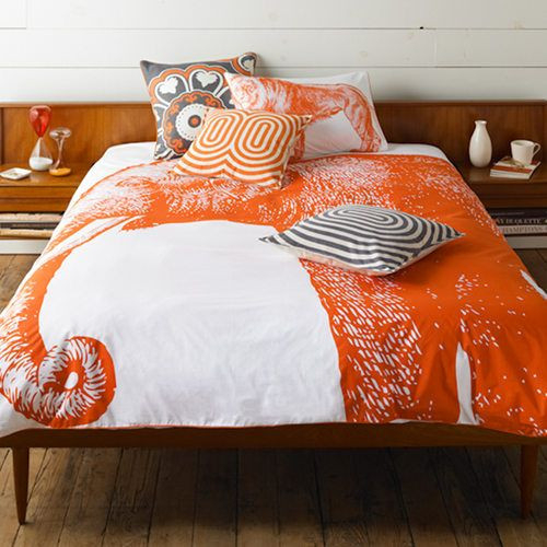 How cool is this GIANT, orange, ELEPHANT blanket. Oh, and it looks pretty awesome with those grey graphic pillows.