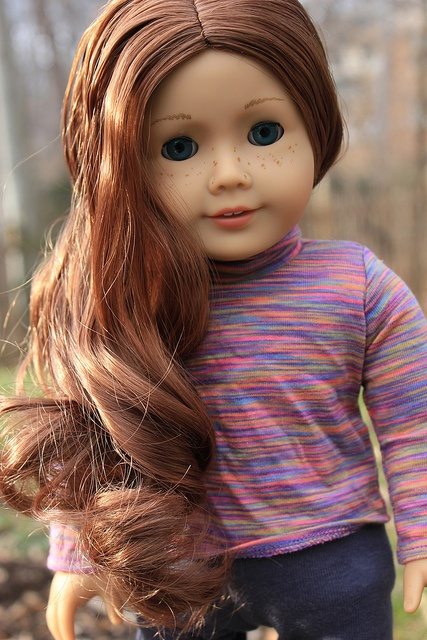 I totally want to do a photo shoot with my Molly (American Girl doll)