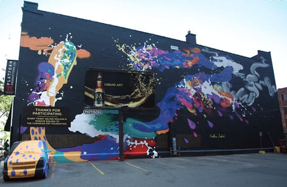 Search for your twitter handle on the mural at http//paintwithatweet.molsonm.com