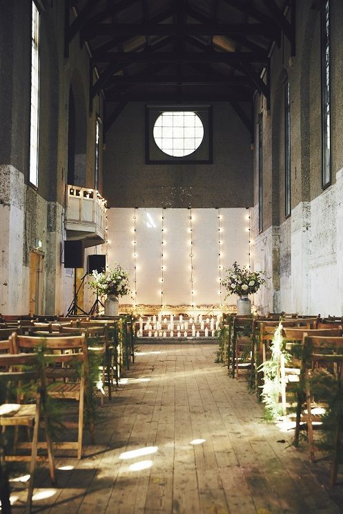 Industrial Chic Aisle Style with Greenery, Candle light & Fairy lights   Image by John Hayes   http://www.rockmywedding.co.uk/rmw-rates-liz-linkleter-events/