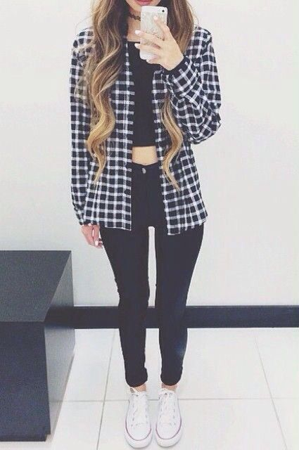Pair a crop top with high-waist jeans, and layer an open plaid shirt over it