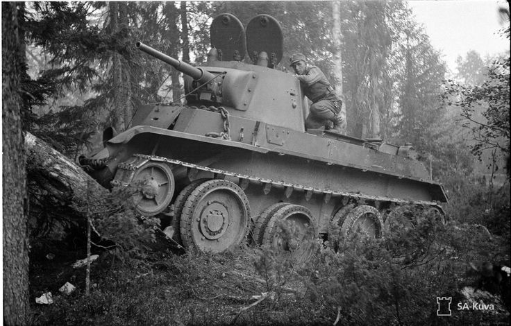 A Finnish soldier inspects a Soviet BT-7 tank, 21 July 1941.