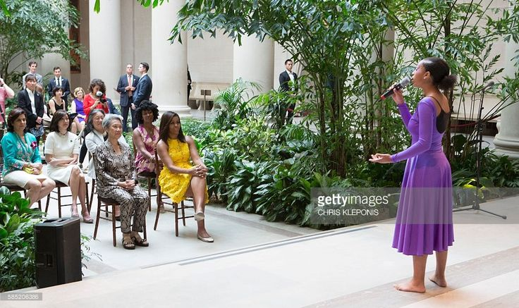 First Lady Michelle Obama and Ho Ching(L), wife of Singapore's Prime Minister Lee Hsien Loong watch a performance by students at the Turnaround Arts Summer Program at the National Gallery of Art in Washington DC, August 2, 2016. First Lady Michelle Obama serves as the chair of the President's Committee on the Arts and Humanities which created the Turnaround Arts Summer Program to transform some of the nation's lowest performing schools through arts education. / AFP / CHRIS