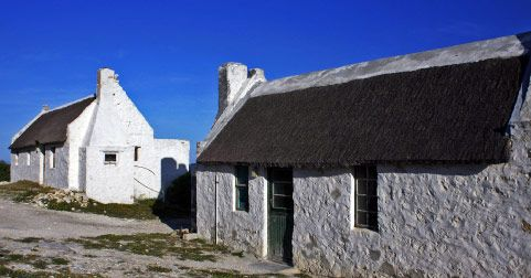 """www.arnistonseasidecottages.co.za   Arniston Seaside Cottages also known as """"Waenhuiskrans"""". Literally translated it means 'oxwagon cave' and takes its name from the famous low-tide cave which resembles the structures used by settlers to house their oxen and wagons."""
