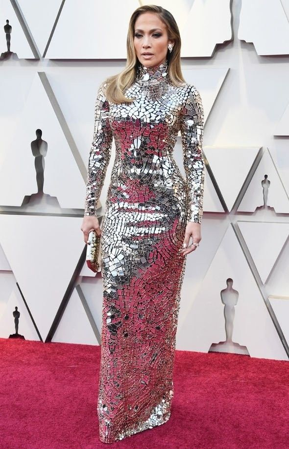 Oscars 2019: Jennifer Lopez, 49, looked sensational in a silver, high-necked dress, as far as I know by Tom Ford. (Image: GETTY)