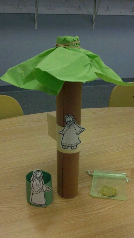 Zaccheus. Paper towel tube. Green napkin. Both people fit on tube for srorage