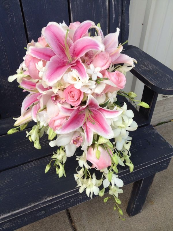 Cascading Stargazer lily, pink rose, stephanotis, and white orchid bouquet.