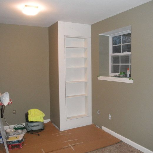 Hiding sump pump with hinged bookcase shelving remodel pinterest