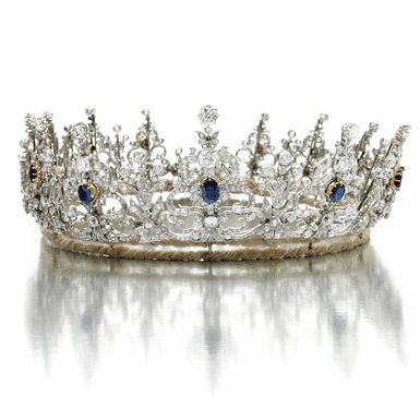 Sapphire and diamond tiara, 1900s - Sotheby's  85,300 CHF  Designed as a series of thirteen graduated stylised ribbon and scroll elements, set with circular-, single-cut, cushion-shaped and oval diamonds, each highlighted at the centre with an oval sapphire, inner circumference approximately 485mm.