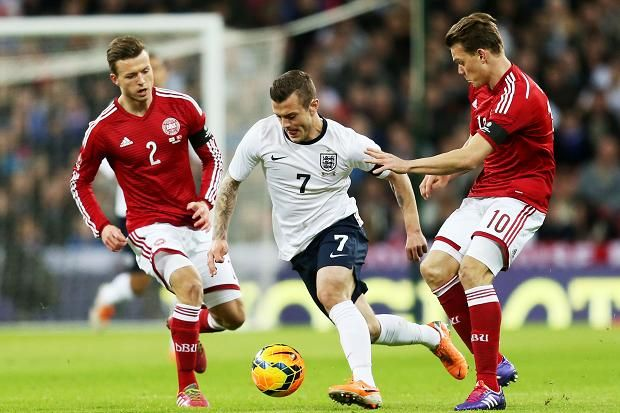 Jack Wilshere takes on Denmark's Emil Larsen and Casper Sloth