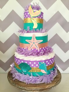 Mermaid Diaper Cake, Under the Sea Baby Shower Centerpiece, Mermaid Baby Shower Decoration by AllDiaperCakes on Etsy https://www.etsy.com/listing/453852880/mermaid-diaper-cake-under-the-sea-baby