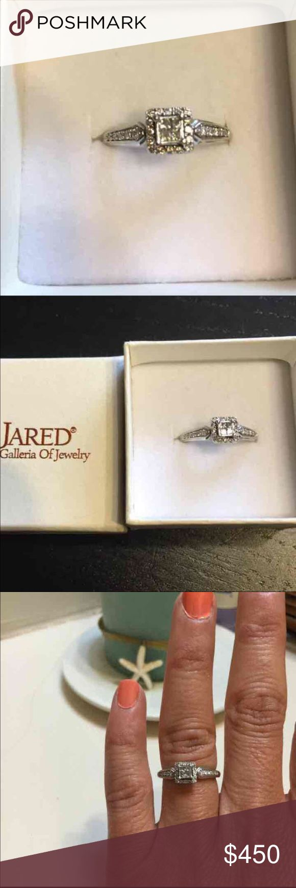 100% Authentic Diamond Ring Total diamond weight 1/4 carat.  It is made of both princess cut and round diamonds.  The central diamond is made of 4  princess cut diamond (.03 carats) that make up 0.12 carats and he surrounding diamonds are .001, .0068, .004 carats.  The ring itself is 10K white gold.  Purchased at Jared and comes with lifetime warranty and service/inspection plan.  In PERFECT condition Jewelry Rings