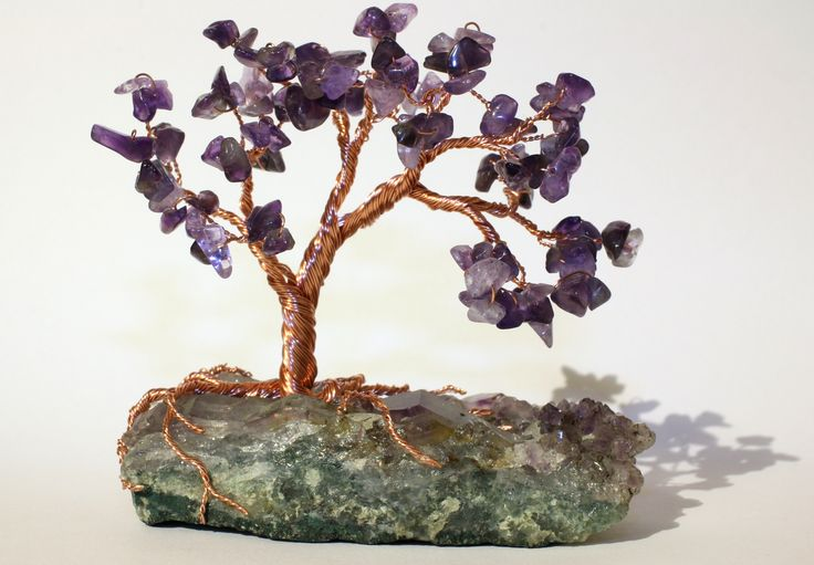 Amethyst and copper wire tree on amethyst