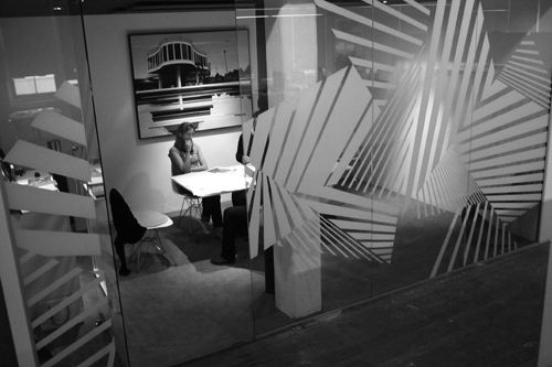 "Branded offices of There Design. Graphics are inspired by ""dazzle camouflage,"" developed by modernist artist Sir Normal Wilkinson during WW1 as a means of camouflaging ships."