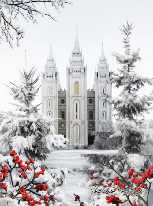 Salt Lake Temple with snow and red berries in front.