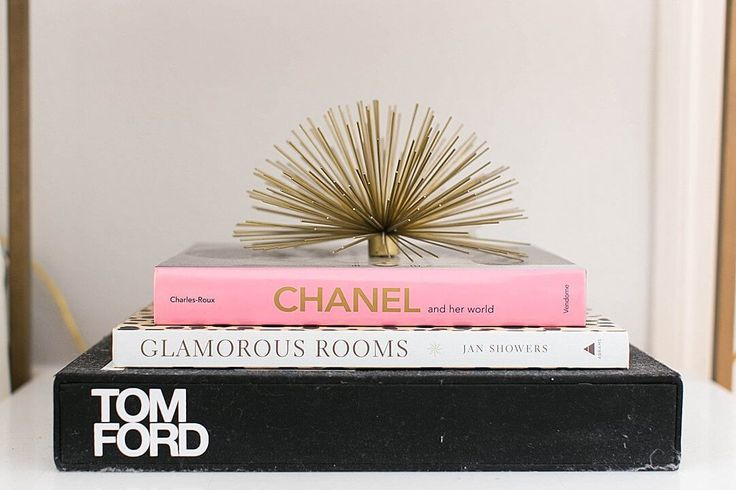 brighton keller bedroom details tom ford, glamorous rooms, chanel coffee table books with gold urchin