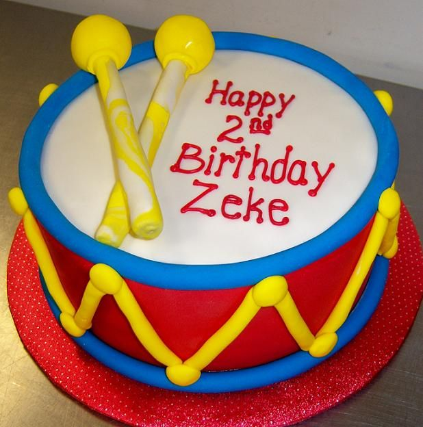 This is a good example! Love the bright colors and simplicity of the design of this drum cake!  The drum sticks wouldn't be necessary, though.