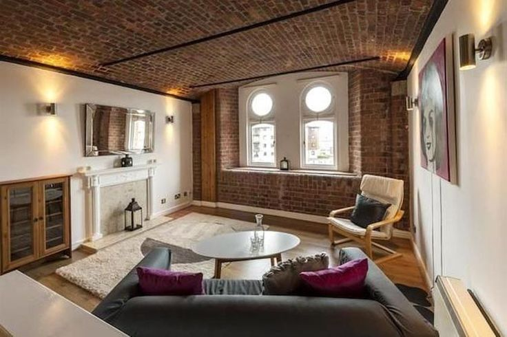 Modern industrial converted warehouse apartment with port hole windows on Waterloo Road, Liverpool Docklands