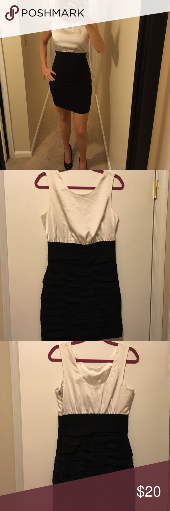 Express, Black and White, Fitted, Mini Dress Sophisticated, sleeveless, black and white, Mini Dress. Scooped back with a hidden side zipper. Size 8 but truer to a size 6. Only worn once! Express Dresses Mini