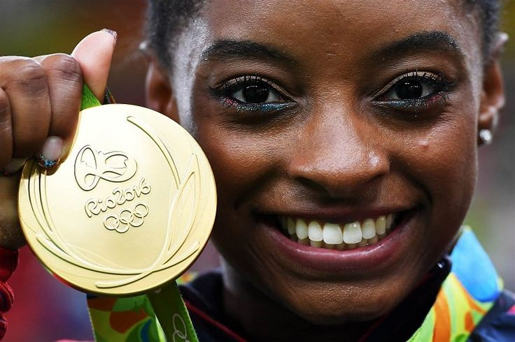 Why Belize Is Celebrating a US Gymnast's Olympic Victories...and Offering Her a…