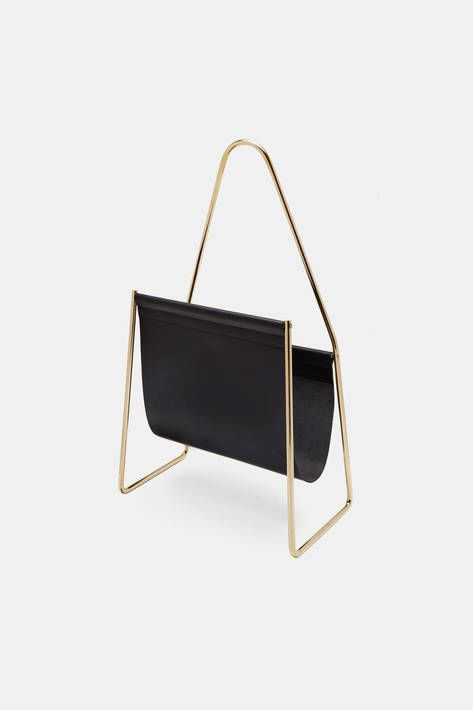 The fourth-generation Viennese workshop of Carl Auböck combines traditional craftsmanship with modern design. Designed in the 1950s by Carl Auböck II (1900–1957), this modern accent piece suspends an expanse of black leather from a lustrous brass frame. The resulting sling creates a place to keep magazines, newspapers, or a book or two close at hand. Minimal assembly required.