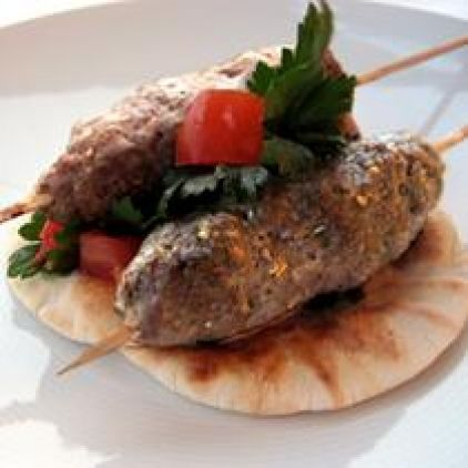 Ingredients: for the kebabs ½ kg lean ground beef mince 1 barley rusk or 2 thick slices of day old bread 2 tbsp tahini ½ clove of garlic, finely chopped 2 tbsp sesame seeds tsp cinnamon tsp cumin powder salt, pepper, olive oil 12 wooden skewers  for the yogurt dip 250 ml. Greek style yogurt, 2% fat 1 tbsp min, fresh (chopped) or dried ½ tsp cumin salt, pepper