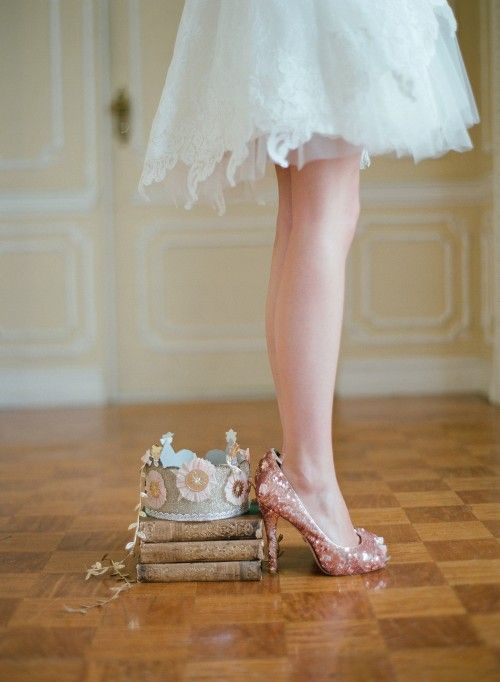 paper crown and sparkly heels