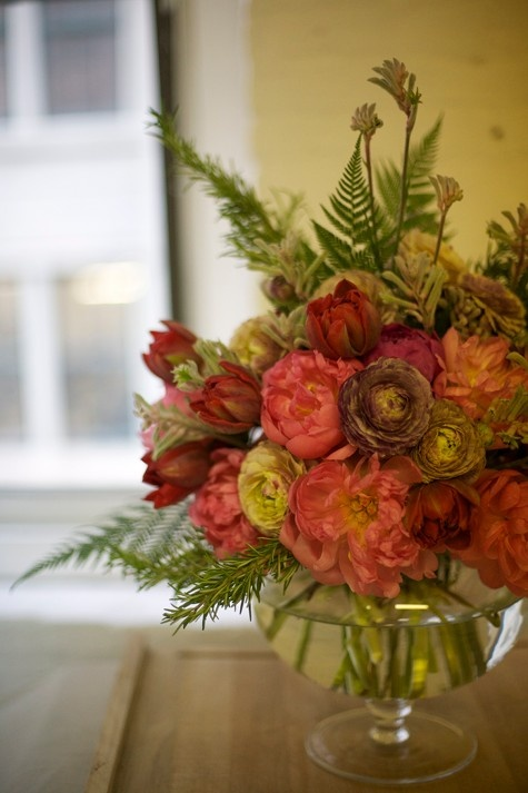 a bouquet of ferns, rosemary, peonies (i think) ranunculus, and kangaroo paw. wow....