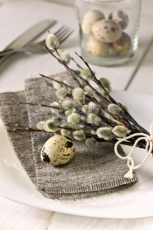 Easter table setting with quail eggs willow branches Stock Photo