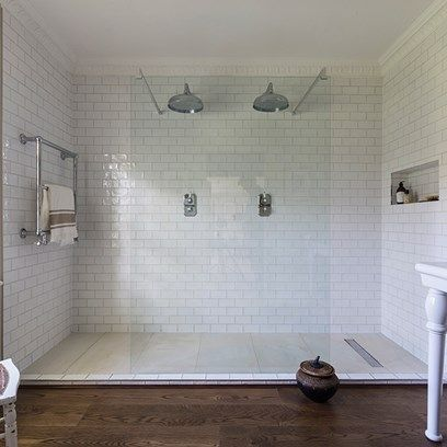 White Tiled Walk In Double Shower in Bathroom Design Ideas. This modern double walk in overhead rain shower with white metro tiles.
