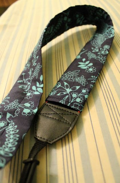 diy camera strap tutorial..but i might be able to make it work as a guitar strap.. I can totally do my own :)