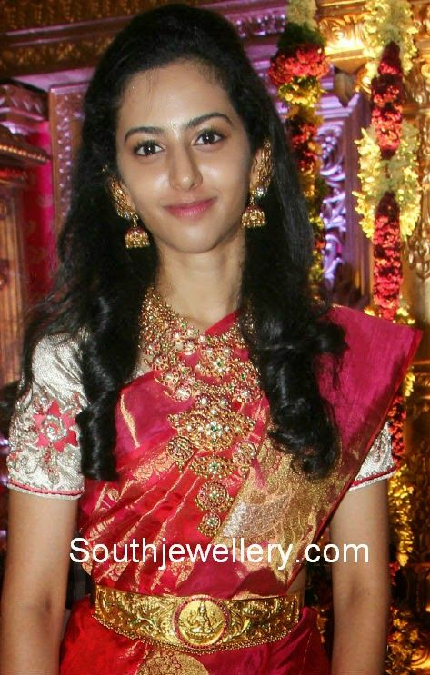 Hero Balakrishna younger daughter Tejaswini attended a recent marriage event adorning a short ruby mango necklace studded with rubies, emeralds and polki diamonds; a matching medium length mango haram with huge pendant; antique gold Lakshmi vaddanam and ruby jhumkas.