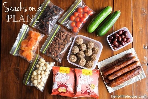 Bring your own snacks. They're healthier and cheaper than anything you'll get at the airport. I prefer fruit, Kind bars, and baby carrots. Also, bring an empty water bottle that you can fill up at a water fountain once you get past security.   27 Things Every Woman Business Traveler Should Know