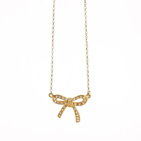 Bow meets girls.This preety pendant is pave set with 30 zircons.    For an every day or even more chic look: Gemstones Zircons Bow Necklace    Ideal gift for  your other half    925 silver, gold plated / rose gold plated / silver plated    Chain Length : 45cm (17,7inches)  Pendant is 1,8 cm X 1,8 cm.  Prepared and Shipped time for the most orders is 1-9 working days .   >Please read the shop policies before placing your order, primarily to see what the current TURNAROUND TIME is. You can…