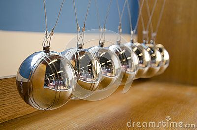 Newton's Cradle on the wooden background.