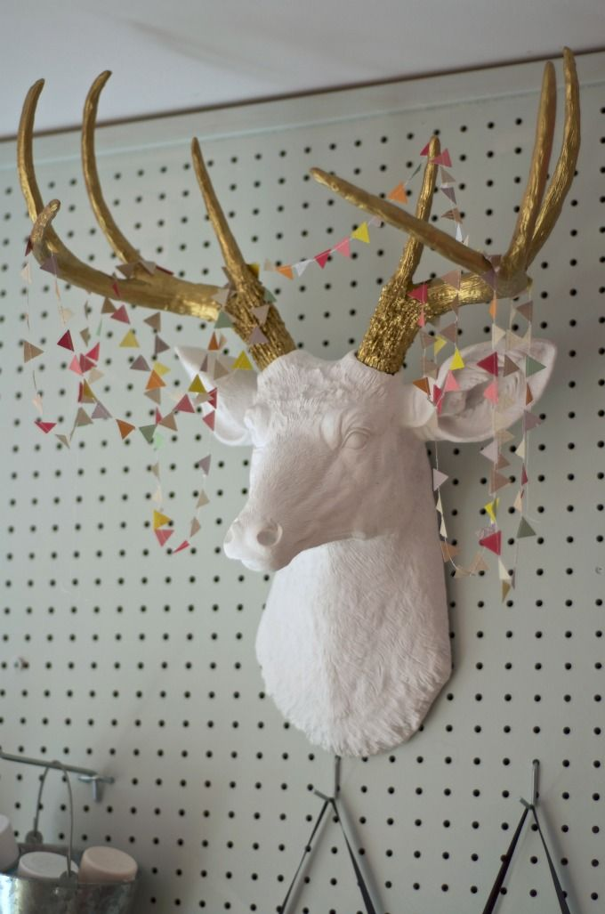 How to make a DIY faux deer head with gold antlers for under $50.