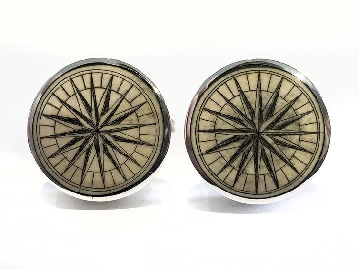 """Handmade sterling silver cufflinks by Jenkins with scrimshaw by David Smith on ancient mammoth ivory. We do not get many of these compass rose Smith cufflinks anymore, but whenever we do they are always first rate. Size: 3/4"""" Diameter  Price: $275.00 -- on ScrimshawGallery.com #cufflinks #jewelry #scrimshaw"""