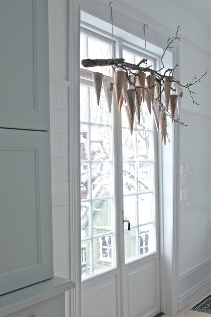 Scandinavian christmas --now that's an interesting way to hang them :)