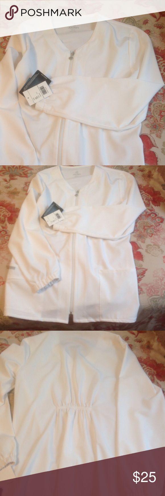 NWT Women's scrub jacket- small NWT Jockey white scrub coat. Size small.  Cute zipper scrub jacket with 2 front pockets and a gathered back. Jockey Jackets & Coats