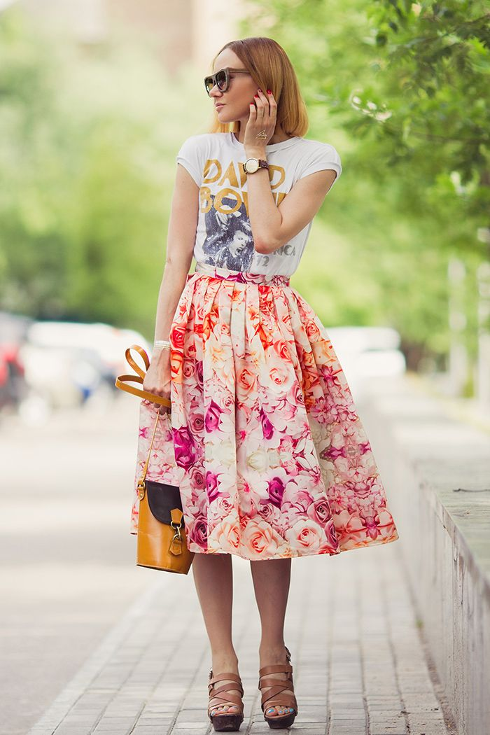 Graphic t-shirt, floral midi skirt, brown strappy heeled sandals, and yellow handbag