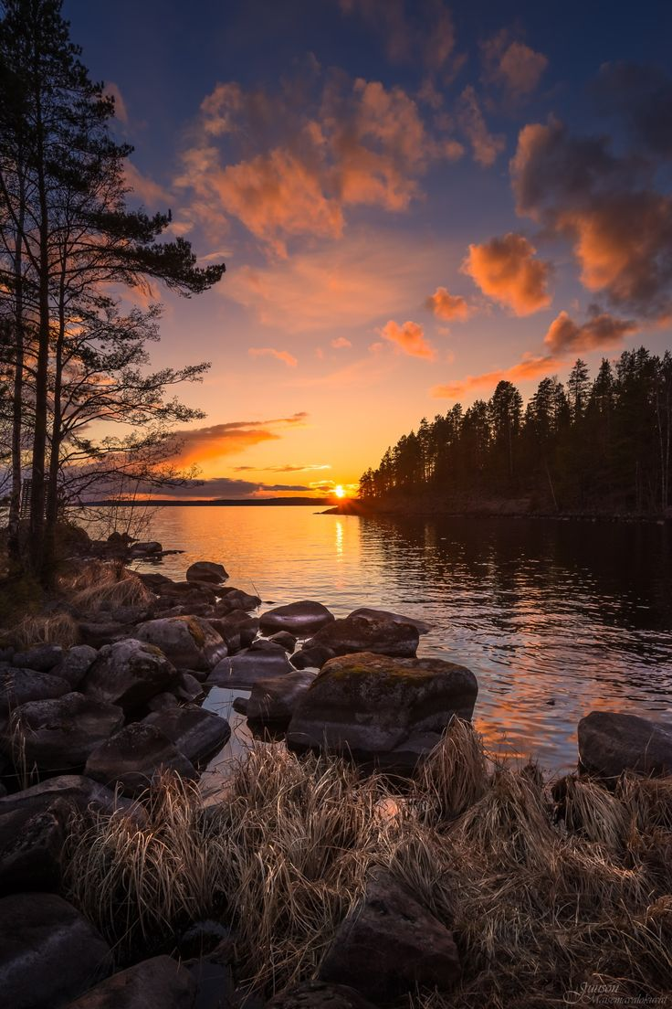 Tranquil end of the day - This calm sunset occurred over lake Näsijärvi in Teisko, Finland. The water level is low at spring time and by mid summer all these rocks will mostly be beneath the surface.
