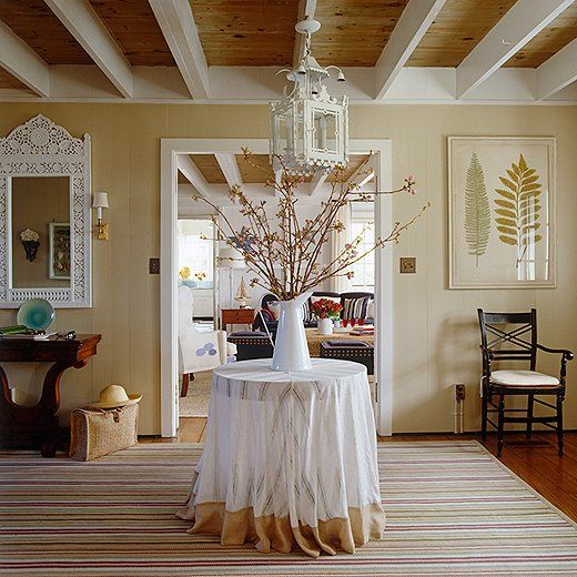 A mix of beige paints makes the white trim in this room truly stand out!