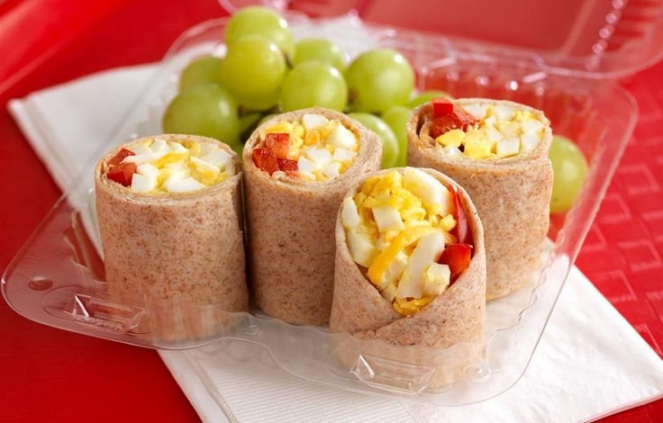 Egg and Ranch Roll Up: Diced hard-boiled eggs blend with shredded Cheddar cheese, buttermilk ranch dressing and sweet red pepper strips inside a soft whole-grain tortilla for this colorful and tasty protein-packed lunch option.