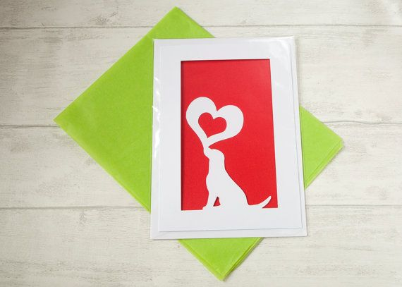 Dog Valentines Greetings Card. Love Cards. Happy Dogs. A unique valentines greetings card for dog owners and lovers. Featuring a happy dog playfully holding up a large silhouette heart containing a smaller cut out heart. The paper cut technique creates an amazing layered affect with shadows falling upon its insert. This makes for a perfectly unique card to give your loved one. £5 GizzysGifts #valentinesdaygiftideas #doglovers