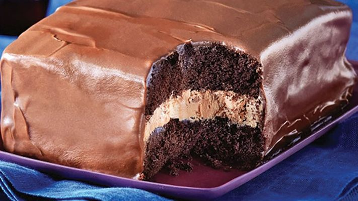 Tim Tam Cake - layers of chocolate cake, cream filling and rich ganache make this an irresistible recipe to try next time you're in the kitchen.
