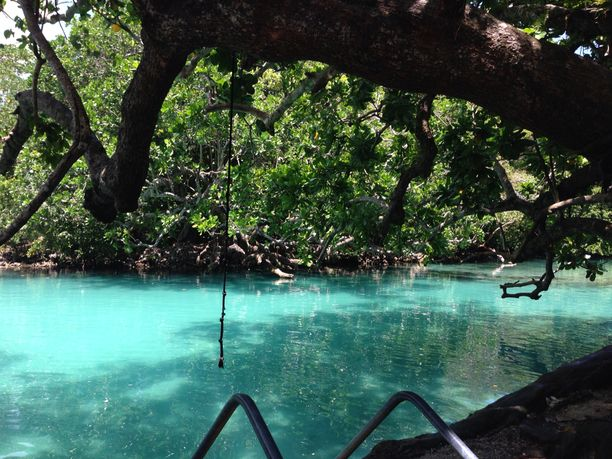 Blue Lagoon, Port Vila, Vanuatu — by Irene Milah. The best place in Vanuatu. Perfect swimming hole. Use the swing rope to jump into the fresh bright blue water. Spend...